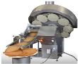 Machine à plaques pour la production automatique de produits fins