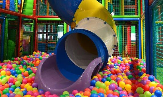 Ideal playground for children with a slide that leads into a pool of plastic ballls.