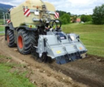 Mix in of Alphasoil®-06-Working-Solution by FAE-RSM-Stone-Crusher-Miller with digital injection and CLAAS-Xerion-Tank-Truc