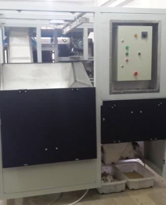 the machine treats the biscuits waste and push both out to two separating exits