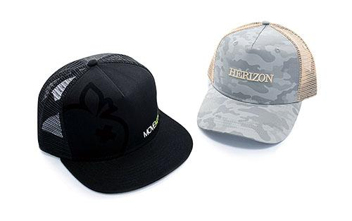 We can produce all kinds of trucker hats, like this black 5 panels snapback trucker featuring a felt print and a flat embroidery or this sublimation printed 5 panels baseball trucker with embroidery.
