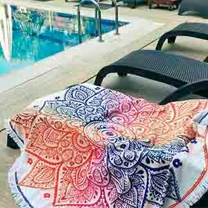 Round beach towel with colorful mandala print and white fringes