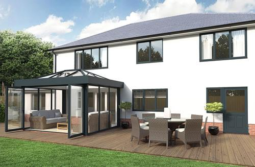 Black orangery home extension with large glass walls