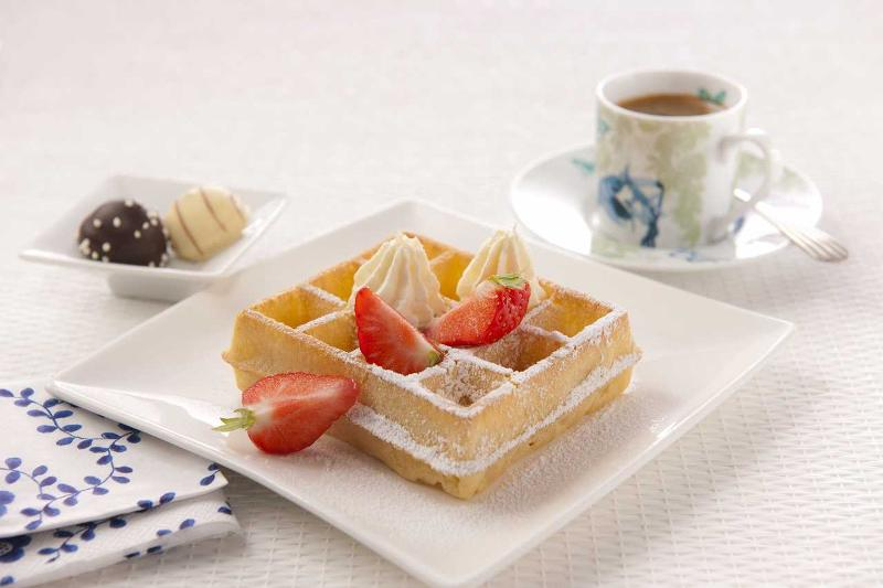 Brussels Waffle prepared  with whipped cream and strawberries. Directly from freezer: 4 minutes in an oven