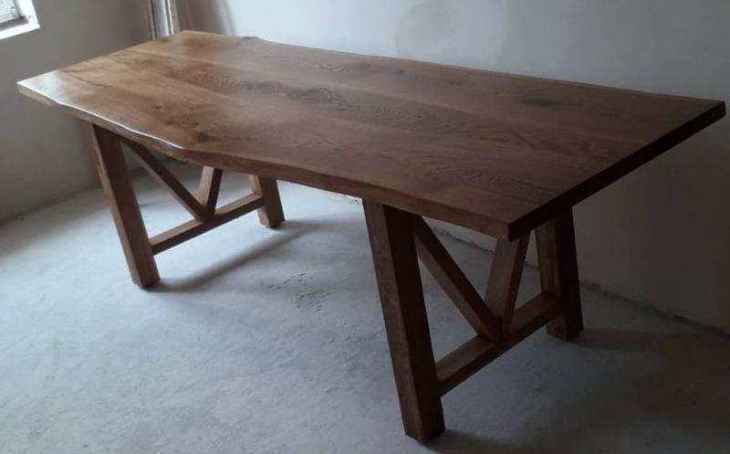 Furniture. Interior. A table made of oak massif. Designer tables.