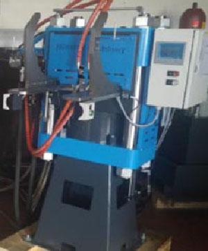 Machine pour le pressage des disques vinyles