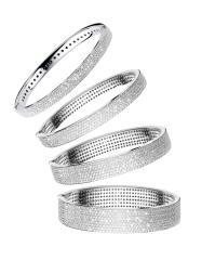 Manhattan bracelets in white gold and white diamonds.