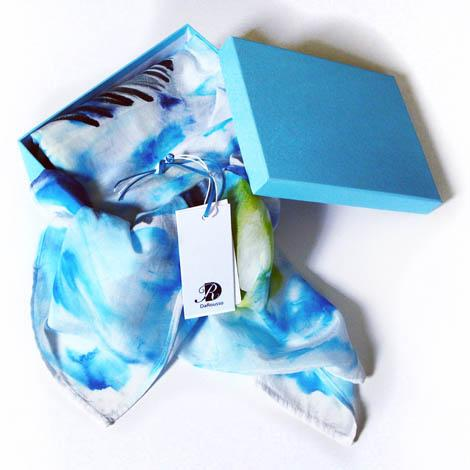 The accessories collection features scarfs and other fabric accessories made from silk and cotton which are hand painted individually. Each piece is unique.