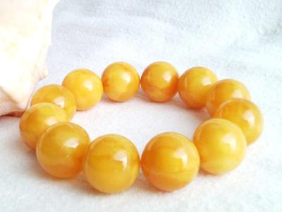 Amber bracelets Chinese honey Size balls 10-20 mm  Price: 3,5 € / Gram  Vendor code: F-12