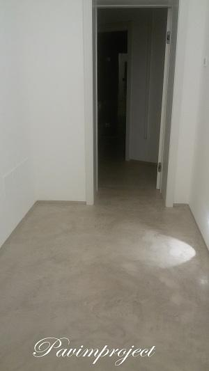 Floor and skirting microcemento, continuous surface.