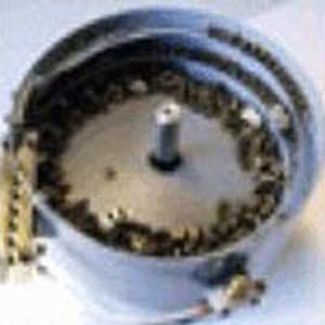 Basi vibranti con contenitori cilindrici