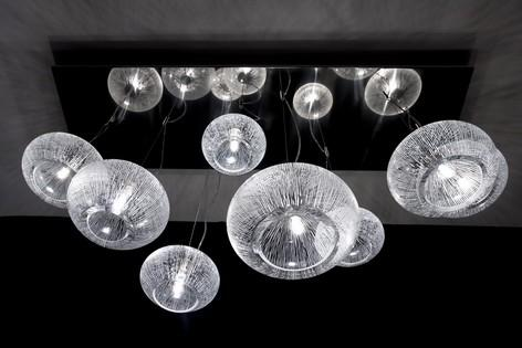 Chandelier 8 globes of different sizes mouth blown in our glass studio. Decor herbal. Brushed stainless steel platter. Pan size: 140x40cm 230V supply. G9 halogen lights - 60W or LEDs.