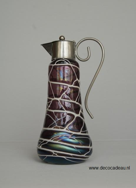Art Nouveau jug in amethyst colored iridescent glass, with a white veined decoration.