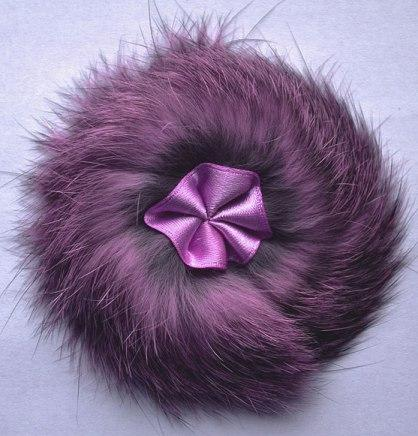 """An accessory (""""flower"""") made of rabbit fur for shoe and clothes decoration."""