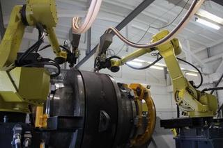 Flux welding robotic cell