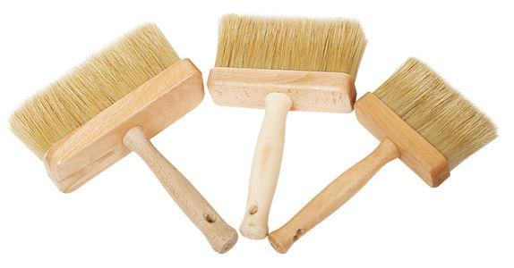 Wallpaper paint brush with wooden head.