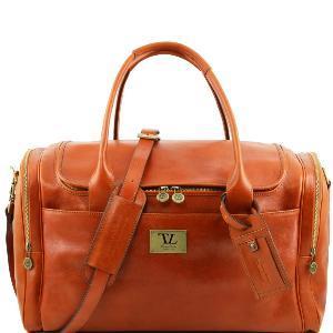 Grand sac de Voyage cuir avec poches sur les côtés Dimension 51.5 x 28 x 24.5 cm Bandoulière en cuir.Partie intérieure:1 compartiment Poche à l'intérieur avec glissière Poche multifonction
