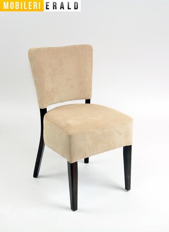 Chair with seat and back upholstered and with wooden legs.