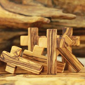 Hand made olive wood small crosses. We can make any size of small olive wood crosses.