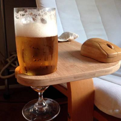 The photo shows the arm- and mouse support in action with a chilled glass of beer.
