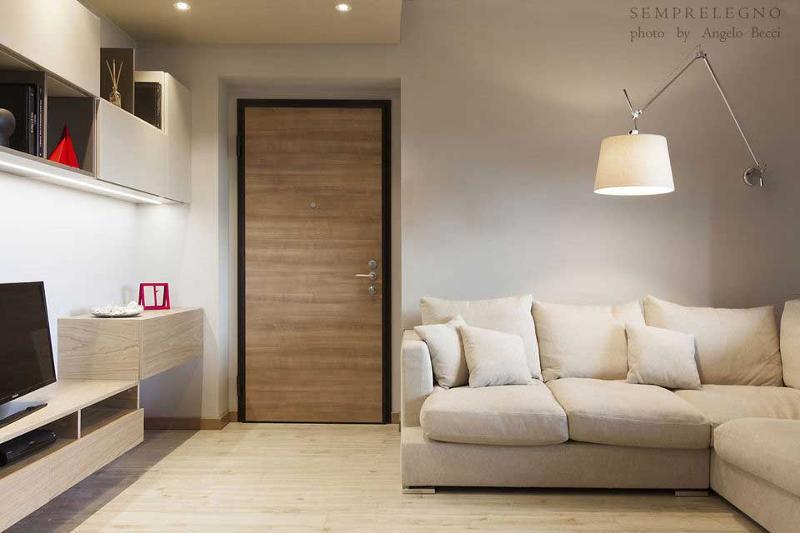 Mobili per soggiorno di design progettati ed eseguiti su misura dalla falegnameria Semprelegno di Lissone. Ambiente aperto (salotto con cucina a vista) con arredi sospesi da terra in stile lineare.