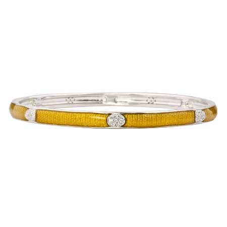 This gorgeous bangle in yellow snake skin style enamel can be worn as a single piece of jewellery or stacked on the wrist with other bangles of similar design to create a layered look.