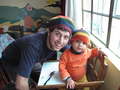A volunteer and child with similar hats