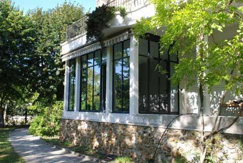 Extension de maison gamme Fineline avec vitrages chauffants