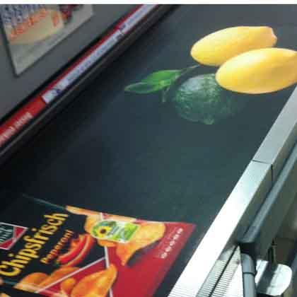 Brand and fruit advertisement is printed on this conveyer belt by PRINTBAND.