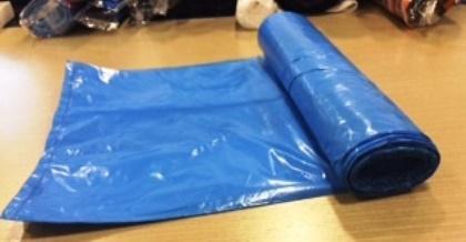 Blue color garbage bag on roll