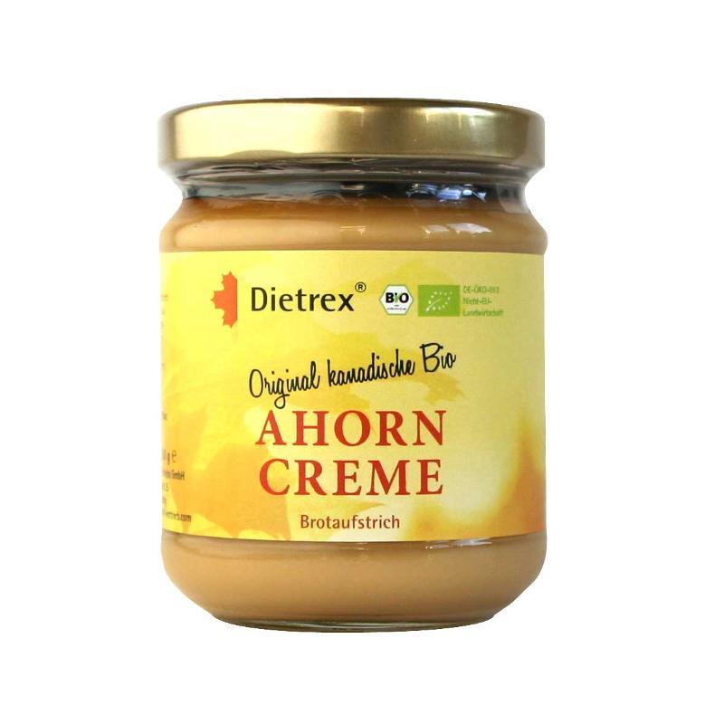 Die Dietrex® Ahorncreme ist ein pflanzlicher Brotaufstrich, der durch Eindicken von Ahornsaft über das Stadium des Sirups hinaus entsteht. Es handelt sich um ein reines Naturprodukt ohne Zusatzstoffe.