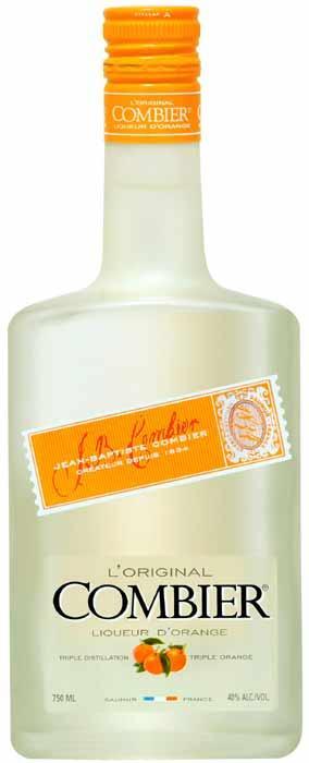 Fabricant triple sec Original Combier. Triple sec à base d'écorces d'oranges douces et amères. Zestage manuel des peaux d'oranges et triple distillation.