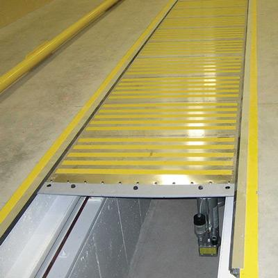 Steelflex roll-up systems are designed to protect openings on large machinery or to cover e.b. inspection pits. They enhance safety of personnel and protect against damage/soiling.