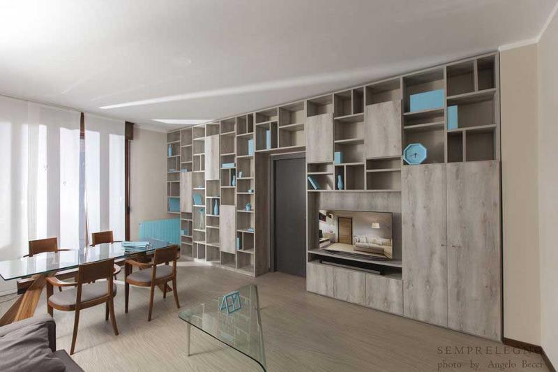 Libreria di design su misura e arredamenti per soggiorno con zona pranzo