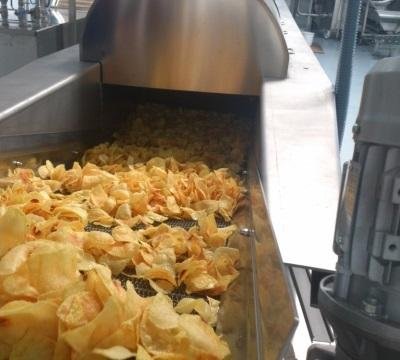 Complete lines for frying chips, nuts, snacks and packaging machines with multihead weighers.