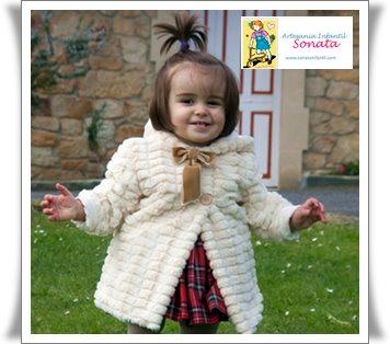 Nice beige coat for the winter. Very warm. Excelent quality. Designer baby clothes.