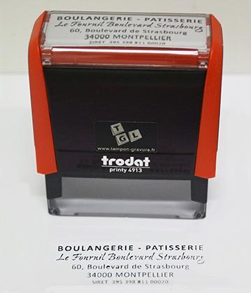 Exemple de tampon commercial pour une boulangerie pâtisserie. Le caoutchouc personnalisé est monté sur un Printy 4913 de Trodat.