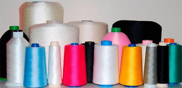 Hilo de coser; poliéster fibra cortada, corespun poliéster-algodón, corespun poly-poly, filamentos de poliéster y de poliamida de alta tenacidad y otros relacionados.