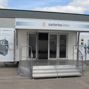 Hired long term, this exhibition trailer was vinyl wrapped by the customer, for added impact. The stage provides more entertaining space & really adds to the wow factor.