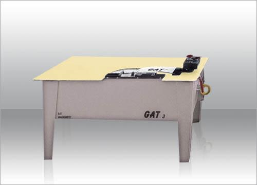 The cutting Machine GAT3 is used for the legs alignment of the wooden seats.