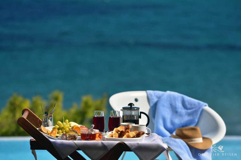 breakfast in a luxury rental villa on the pool deck