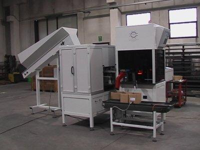Machine with optical controls and glass table for dimensional and surface controls.