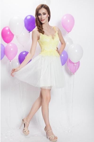 Made of yellow lace and white tulle, this short dress is the perfect choice for the most special moments which require a festive outfit, with a distinguished and delicate design.