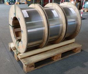 Flat wire on three wooden spools packed on a standard pallet - ready for shipment by Studer-Biennaform (http://www.PrecisionFlatWire.com).