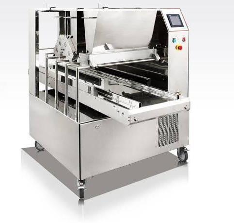 TRIOMIX 600. This 9 row versatile dropping machine is designed for the production of