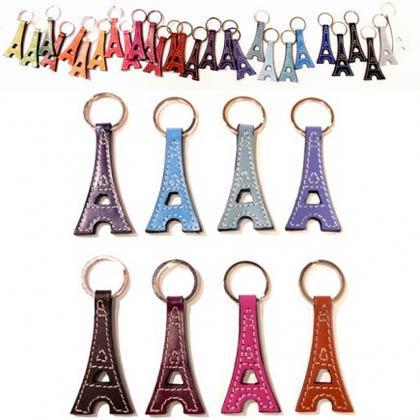 Porte-clés ayant la silhouette de la tour Eiffel, fabriqués en double épaisseur dans des chutes de cuir de buffle ou de cuirs recyclés de plusieurs couleurs avec coutures sellier recto verso.
