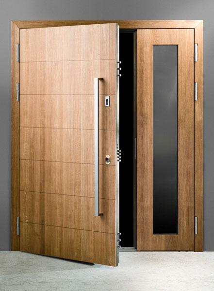 SKYDAS armoured entrance double door with glazing and natural oak finishing.