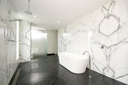 Statuario is an Italien Marble perfect to be use is bathrooms. It will reflect light perfectly.