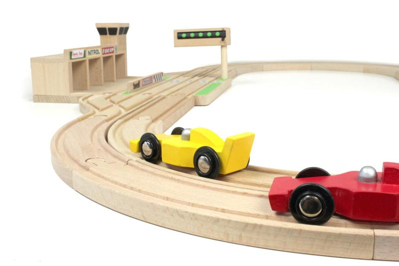 This wooden toy F1 race track is fully compatible with common wooden railway tracks, made out of FSC certified beechwood. 30 pieces incl pitlane and 2 cars.