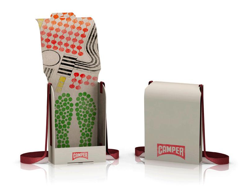 Innovative shoe packaging shaped as a messenger bag. Self-folding system made in corrugated cardboard.